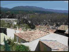 The Luberon hills behind the rooves of Cucuron